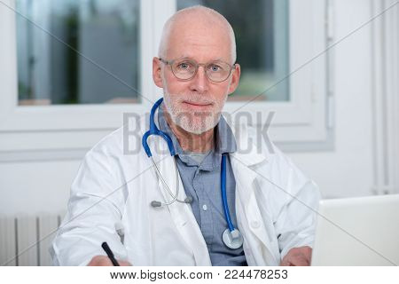 portrait of medical doctor with a  stethoscope