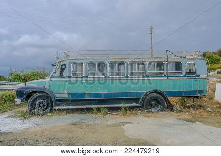 Pachna Village, Cyprus - October 6, 2017: Old local bus left abandoned in a carpark in Pachna village.