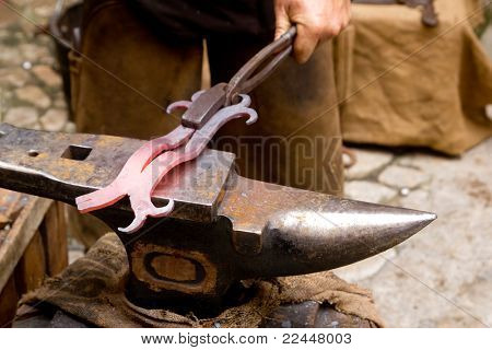 blacksmith forged iron traditional hammer beating