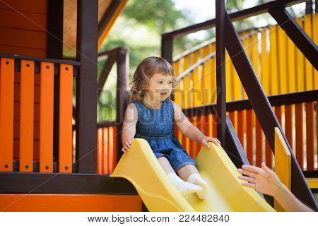 Little Kid On Playground, Children's Slide.