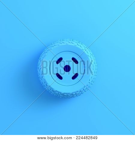 Car wheel on bright blue background. Minimalism concept. 3d render