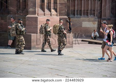 Strasbourg, France - August 11, 2015 : Three french soldiers patrolling in Strasbourg near the Cathedral, France
