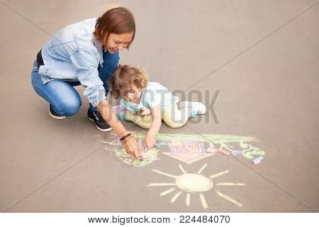 Babysitter Or Kindergarten Concept. Children Drawing With Color Chalk.
