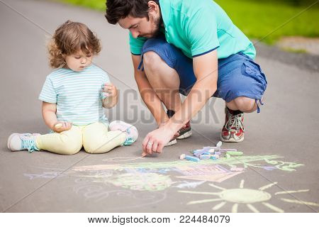 Caring Father, Happy Family. Drawing With Color Chalk. Happy Childhood. Preschooler Leisure Time. Ki