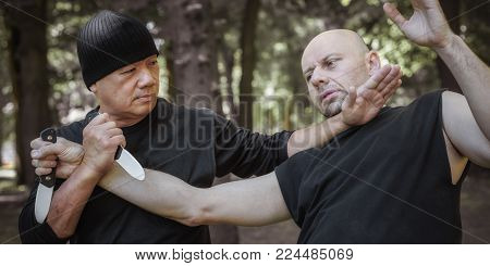 Lameco Astig Combatives Instructor Demonstrates Knife Attack Disarming Technique