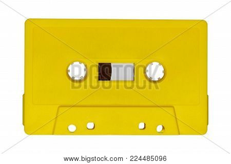 Retro yellow audio tape isolated on white background
