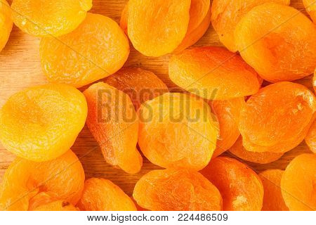 Healthy nutrition diet. Heap of dried fruits apricots close-up orange food background