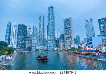 BOAT QUAY, SINGAPORE - AUGUST 14, 2009: Boat Quay, a historical quay in Singapore, situated upstream from the mouth of the Singapore River on its southern bank. The city's financial district is situated in the background.