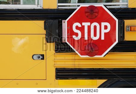 A School bus stop sign background with nobody.