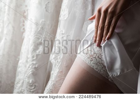 Bride in a night shirt on a wedding day. Beautiful sexy lady in elegant panties and bra