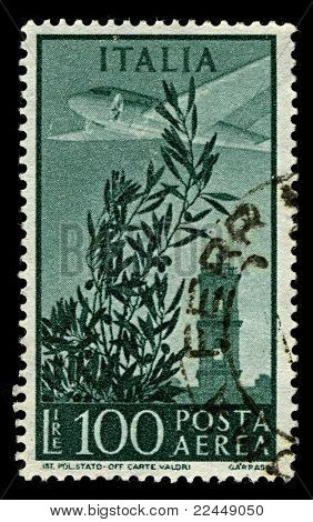 ITALY-CIRCA 1955:A stamp printed in ITALY shows image of The Douglas DC-3 is an American fixed-wing propeller-driven aircraft whose speed and range revolutionized air transport, circa 1955.
