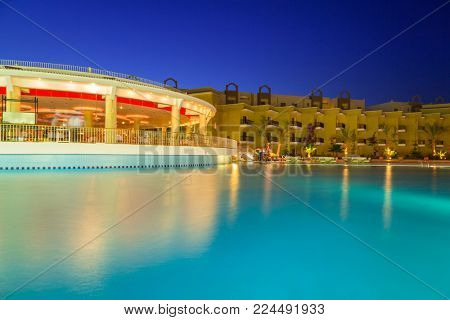 HURGHADA, EGYPT - APR 13, 2013: Tropical resort Three Corners Sunny Beach in Hurghada at dusk. Three Corners is Belgian company with 11 hotels at Red Sea in Egypt and one in Budapest, Hungary.