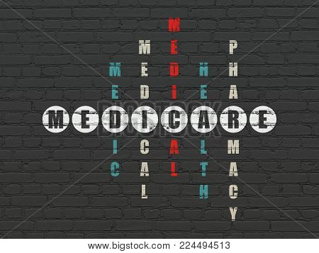 Health concept: Painted white word Medicare in solving Crossword Puzzle