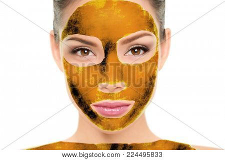 Luxury pure 24k gold mask sheet body wrap and facial treatment beauty Asian woman face portrait. Cosmetology skin care therapy with real golden sheet mask as luxurious product for anti aging.
