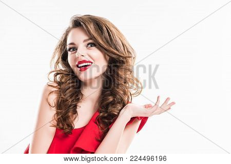 surprised girl in red dress showing shrug gesture isolated on white