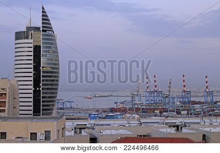 Haifa, Israel - November 27, 2017: the administrative building with government offices and the city port in lower Haifa