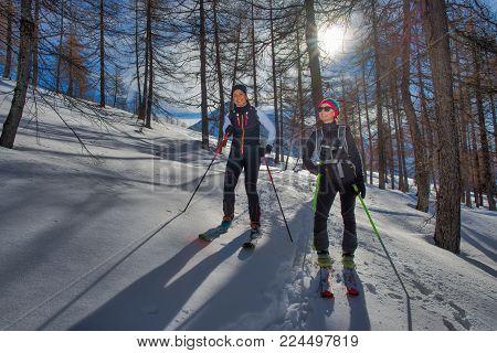 A Couple Of Women Practice Ski Mountaineering