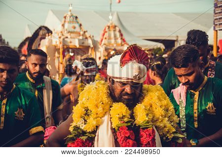 BATU CAVES, SELANGOR, MALAYSIA - 31 JANUARY 2018 Hindu devotees celebrate Thaipusam festival with procession and offerings. People portrait. Religion concept. Culture and traditions. Asia travel