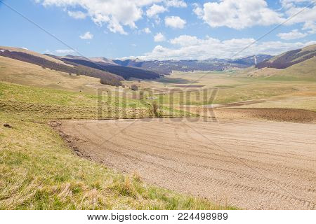 The plateau of Castelluccio di Norcia with fields for the cultivation of lentils