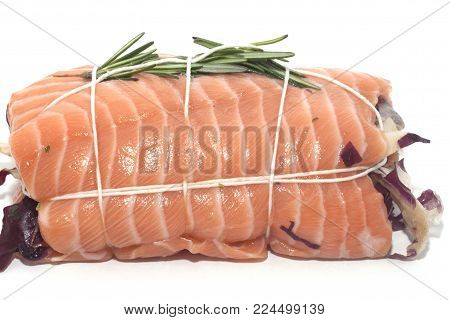 rolled up of salmon stuffed with vegetables