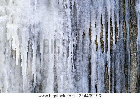 Frozen streams of water on a rock