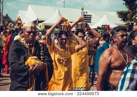 BATU CAVES, SELANGOR, MALAYSIA - 31 JANUARY 2018 Hindu devotees celebrate Thaipusam festival with procession and offerings. People women portrait. Religion concept. Culture and traditions. Asia travel