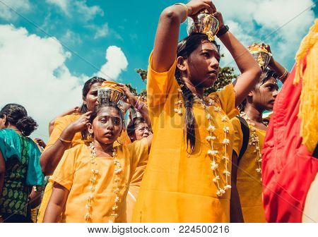 BATU CAVES, SELANGOR, MALAYSIA - 31 JANUARY 2018 Hindu devotees celebrate Thaipusam festival with procession and offerings. Girls portrait. Religion concept. Culture and traditions. Asia travel
