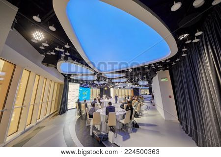 MOSCOW, RUSSIA - OCT 31, 2017: Mercury Space hall of Moskva City business complex with participants of annual conference of Kommersant Publishing House listening to speaker.