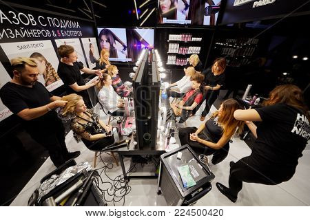 MOSCOW, RUSSIA - OCT 24, 2017: Visagistes perform master-class of making hairdos during Mercedes Benz Fashion Week Russia spring-summer 2018 day four.