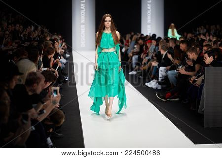MOSCOW, RUSSIA - OCT 24, 2017: Models on catwalk in Manege during performing designer Nikolay Legenda collection at Mercedes Benz Fashion Week Russia spring-summer 2018.