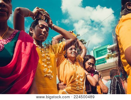 BATU CAVES, SELANGOR, MALAYSIA - 31 JANUARY 2018 Hindu devotees celebrate Thaipusam festival with procession, offerings. Suffering women portrait. Religion concept. Culture and traditions. Asia travel