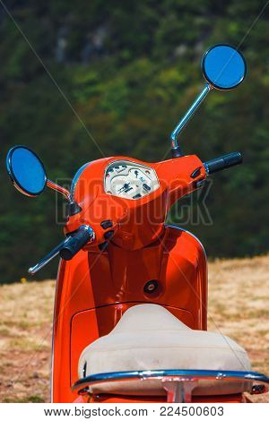 Portugal, Madeira, July 04, 2016: Red Scooter Vespa Parked In The Mountains On Madeira Island, Portu