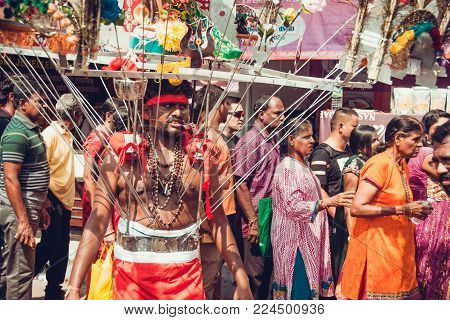 BATU CAVES, SELANGOR, MALAYSIA - 31 JANUARY 2018 Hindu devotees celebrate Thaipusam festival with procession and offerings. Piercing man portrait. Religion concept. Culture and traditions. Asia travel