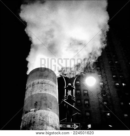 Gritty urban cityscape of a steam vent in New York City