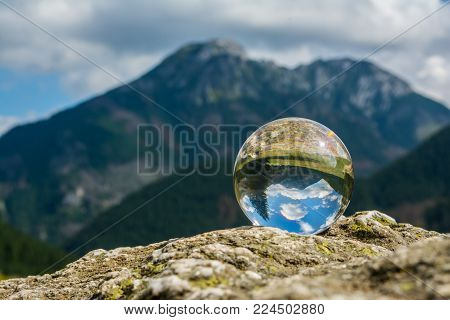a mountain landscape enclosed in a crystal ball