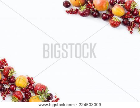 Mix berries isolated on a white. Ripe apricots, red currants, cherries and strawberries. Berries and fruits with copy space for text. Various fresh summer berries on white background. Background berries. Top view.