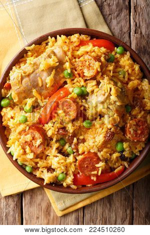 Arroz Valenciana With Rabbit, Chorizo, Vegetables And Spices In A Bowl. Horizontal Top View