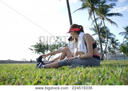 Joggers stretching out in park after exercising