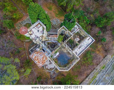 Sochi, Russia - January 2, 2018: Drone view of the abandoned old mansion called Dacha Kvitko among the thicket in autumn day