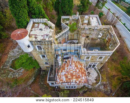 Sochi, Russia - January 2, 2018: Drone view of the abandoned old mansion called Dacha Kvitko near Kurortnyy Prospekt in autumn day