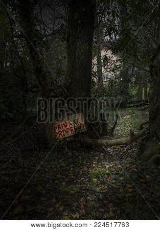 A spooky image of a house with a warning sign not to trespass.
