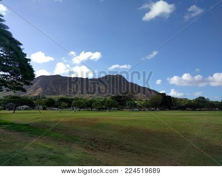 Kapiolani Park At During Day With Diamond Head And Clouds In The Distance On Oahu, Hawaii.