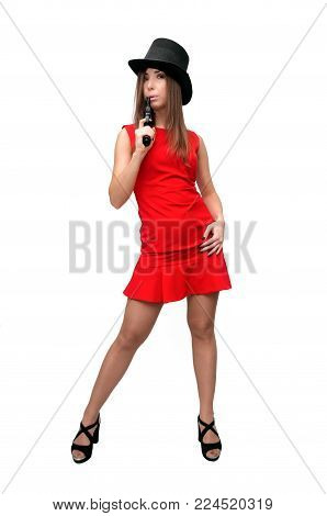 The spy. Special agent. Secret service. Dangerous woman in red dress is holding gun in her hands and is blowing on pistol muzzle isolated on white.