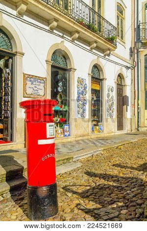 COIMBRA, PORTUGAL - DECEMBER 23, 2017: Street with shops and typical products, and a mailbox, in Coimbra, Portugal