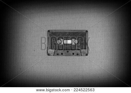 Retro black audio tape on grey dark background
