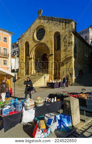 COIMBRA, PORTUGAL - DECEMBER 23, 2017: Flea market scene, with shoppers and sellers, in Coimbra, Portugal