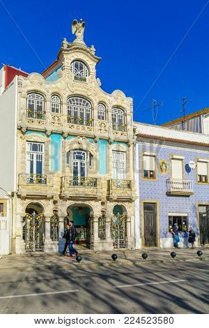 AVEIRO, PORTUGAL - DECEMBER 23, 2017: View of Art Nouveau buildings, with locals and visitors, in Aveiro, Portugal