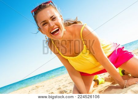 Cheerful Modern Woman In Colorful Dress On Seacoast