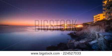 Sunset view of San Antonio beach and Ibiza clubs, Spain