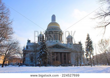 Saint-Petersburg St. Isaac's Cathedral Winter Scene, Orthodox Basilica and Museum Building in Russia. Neoclassical Architecture with Gilded Dome, Colonnades, Sculptures and Mosaics Facade View.